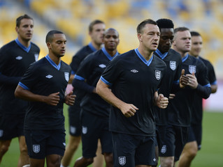 England's national soccer player Terry runs with team mates during a training session ahead of their Euro 2012 soccer match against Sweden at the Olympic stadium in Kiev