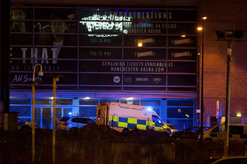 A police van and an ambulance are seen outside the Manchester Arena, where U.S. singer Ariana Grande had been performing, in Manchester