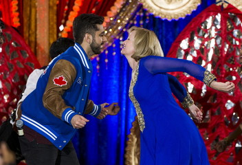 Laureen Harper, wife of Canada's PM and Conservative leader Harper, dances with actor Virmani at a rally with the South Asian community in Brampton