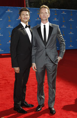 David Burtka and his partner Neil Patrick Harris pose at the 62nd annual Primetime Emmy Awards in Los Angeles