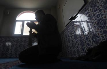 A Turkish man prays at a mosque at the Turkish border town of Ceylanpinar, Sanliurfa province