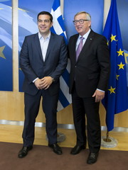 Greek Prime Minister Tsipras is welcomed by European Commission President Juncker ahead of a meeting in Brussels