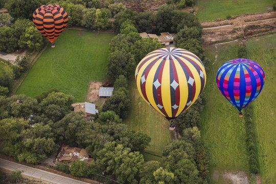 Hot air balloons float over a home during the 2015 Albuquerque International Balloon Fiesta in Albuquerque, New Mexico