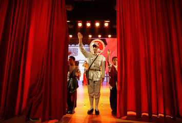 An actor dressed as an Eighth Route Army soldier waves after a performance at the Eighth Route Army Culture Park in Wuxiang county