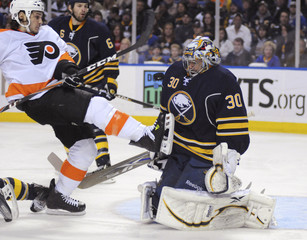 Buffalo Sabres' Miller makes a save against Philadelphia Flyers' Carcillo during their NHL Eastern Conference hockey game in Buffalo
