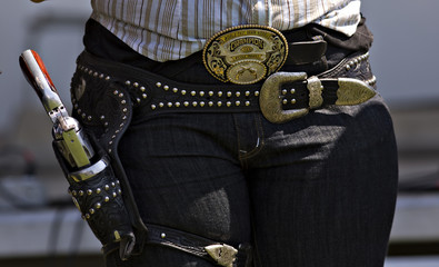 Franks of Aldergrove wears a World Championship belt buckle along with her gun during the Canadian Open Fast Draw Championships in Aldergrove