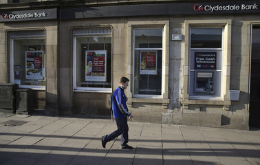 A man walks past a Clydesdale Bank in Edinburgh, Scotland