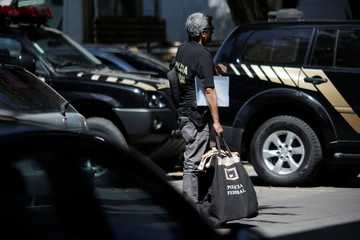 Agent of Brazilian federal police is seen during an operation of issuing detention order against former billionaire Eike Batista amid a series of raids related to the country's biggest corruption probe, in Rio de Janeiro