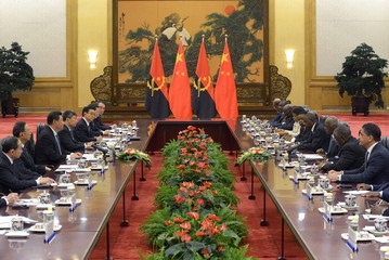 Angola's President Jose Eduardo dos Santos meets with China's President Xi Jinping (3rd L) at the Great Hall of the People in Beijing