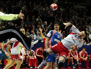 Poland's Jurecki shoots on goal next to Croatia's Valcic during their Men's European Handball Championship semi-final match in Vienna