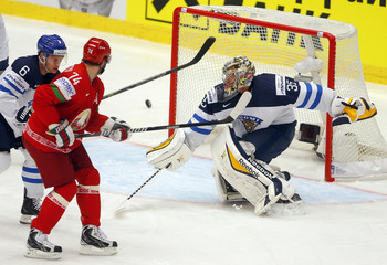 Finland's goaltender Rinne defends past Mantyla and Kostitsyn of Belarus during their Ice Hockey World Championship game at the CEZ arena in Ostrava