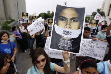Students take part in a silent march against drug related violence in downtown Monterrey