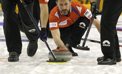 Czech Republic skip Snitil delivers his stone during play against France at the World Men's Curling Championship 2012 in Basel