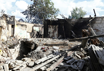 House damaged by fighting between Ukrainian forces and pro-Russia separatists is seen in Slaviansk