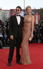 "U.S. actress Hudson and British musician Bellamy arrive for the red carpet of the movie ""The Reluctant Fundamentalist"" at the 69th Venice Film Festival"
