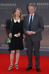 Television anchorman Monfort and wife pose during a photocall for the official inauguration party of Peninsula Paris luxury hotel in Paris