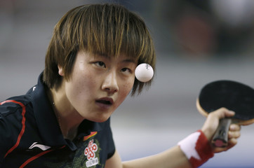 China's Ding Ning serves to compatriot Liu Shiwen during the women's singles final table tennis match at the ITTF Pro Tour Qatar Open in Doha