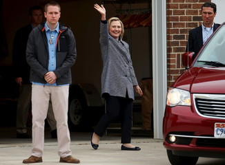 U.S. presidential candidate Hillary Clinton waves as she leaves a campaign event in Mason City