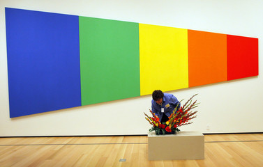 "Marisa McCoy, from the Wareham Garden Club, works on a floral arrangement related to Ellsworth Kelly's painting ""Blue Green Yellow Orange Red"" for Art In Bloom at the Museum of Fine Arts, Boston"