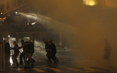 Police use water cannon during clashes with protesters in Tbilisi