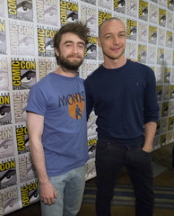 """Cast members Radcliffe and McAvoy pose at a press line for """"Victor Frankenstein"""" during the 2015 Comic-Con International Convention in San Diego"""