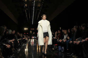 A model presents a creation by French designer Guillaume Henry as part of his Fall-Winter 2013/2014 women's ready-to-wear for fashion house Carven in Paris