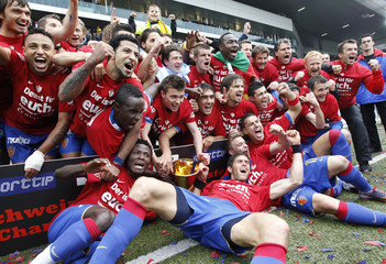 FC Basel players celebrate with the trophy after winning their final Swiss Super League soccer match against BSC Young Boys in Bern