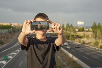 Boy taking a photo