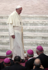 Pope Francis leaves at the end of a meeting with catechists in Paul VI hall at the Vatican