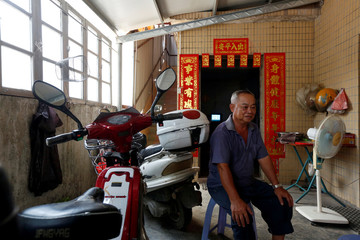 A villager undertakes a health research project on Shazai Island in Guangzhou, China
