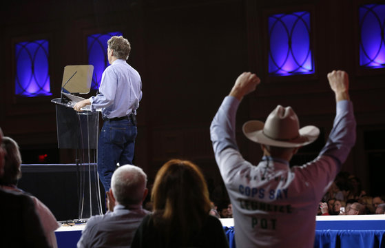 A man in a cowboy hat cheers Senator Rand Paul as he speaks at the Conservative Political Action Conference at National Harbor in Maryland
