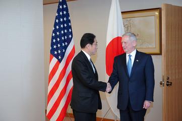 U.S. Defense Secretary James Mattis and Japan's Minister of Foreign Affairs Fumio Kishida shake hands ahead of their talks in Tokyo