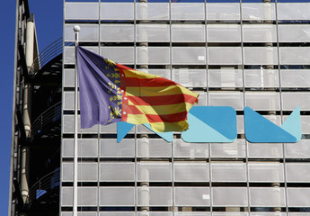 A Valencian flag waves next to the central building of public broadcaster Radio Television Valenciana (RTVV) in Valencia