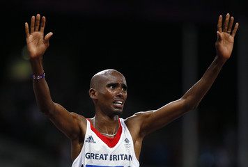 Britain's Mo Farah reacts after winning the men's 10,000m final at the London 2012 Olympic Games