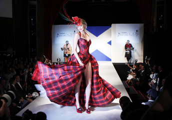 Miss Scotland Katharine Brown presents a creation during the Dressed To Kilt charity fashion show in New York