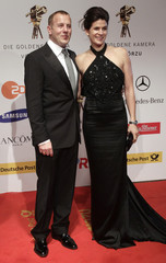 German actor Ferch and wife Marie-Jeanette arrive on the red carpet for 45th Golden Camera awards ceremony in Berlin