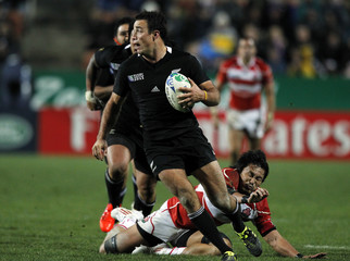 New Zealand All Blacks' Richard Kahui runs with the ball during their Rugby World Cup Pool A match against Japan at Waikato Stadium in Hamilton