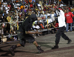"Local stick fighters square off against each other in an arena known as the ""gayelle"" in Mayaro"