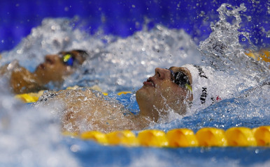Kawecki of Poland competes in the men's 200m backstroke heats at the European Swimming Championships in Berlin