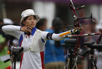 South Korea's Bo Bae-ki fires an arrow during the women's archery individual ranking round of the London 2012 Olympics Games at the Lords Cricket Ground in London