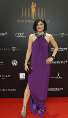German actress Tabatabai poses on the red carpet before the German Film Prize (Lola) ceremony in Berlin