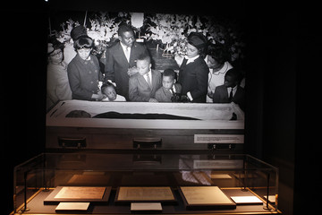 The death certificate of Martin Luther King, Jr., along with other documents following his assassination, is seen below a picture of the family at his funeral, at the new National Center for Civil and Human Rights in Atlanta