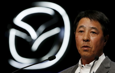 """Mazda Motor Corp President and CEO Masamichi Kogai delivers a speech at the unveiling the company's new open-top sports car """"Roadster"""", also known as """"MX-5"""" in overseas markets, in Tokyo"""
