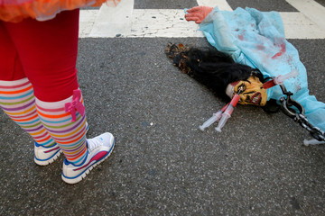 A model of a corpse lays on the ground before the Greenwich Village Halloween Parade in Manhattan, New York, U.S.