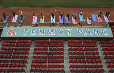 Participants take part in the first ever public yoga session at Fenway Park, home of MLB's Boston Red Sox, in Boston
