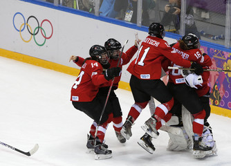 Switzerland celebrates after defeating Sweden at the end of their women's ice hockey bronze medal game at the Sochi 2014 Winter Olympic Games