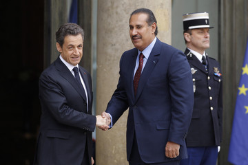 France's President Sarkozy greets Qatar's Prime Minister Sheikh Hamad bin Jassim bin Jaber al-Thani at the Elysee Palace ahead of international talks on Libya in Paris