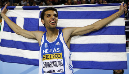 Chondrokoukis of Greece reacts after winning the gold medal at the men's high jump final during the world indoor athletics championships in Istanbul