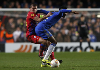 Steaua Bucharest's Bourceanu challenges Chelsea's Obi Mikel during their Europa League soccer match at Stamford Bridge in London