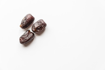 Dates or kurma over white background